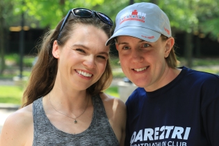 Scott Flathouse also took this photo of me and Randi the day after the race. Randi and I are both smiling and have proud, satisfied looks on our faces. Randi is wearing a Dare2Tri shirt and her IMTX finisher's hat.